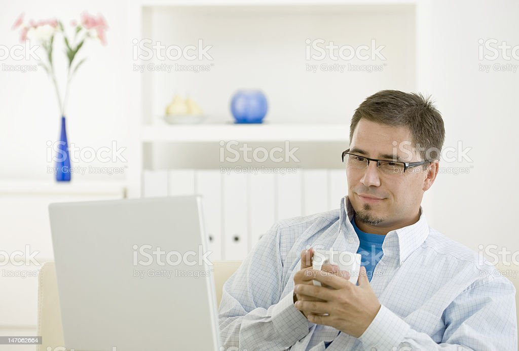Man using computer at home royalty-free stock photo