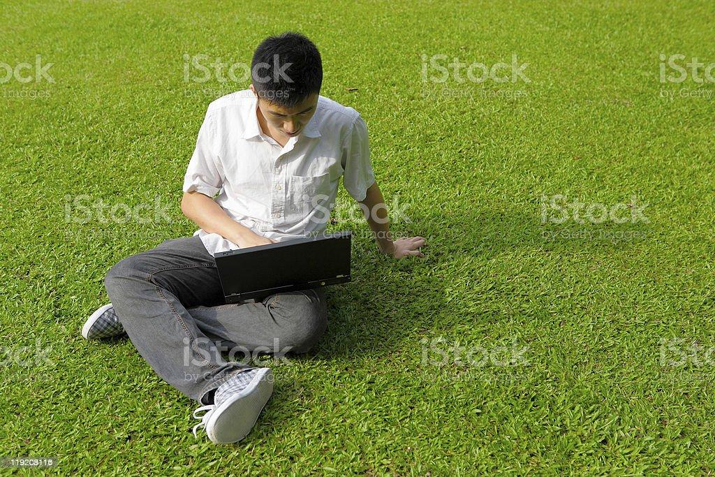 man using computer outdoor stock photo