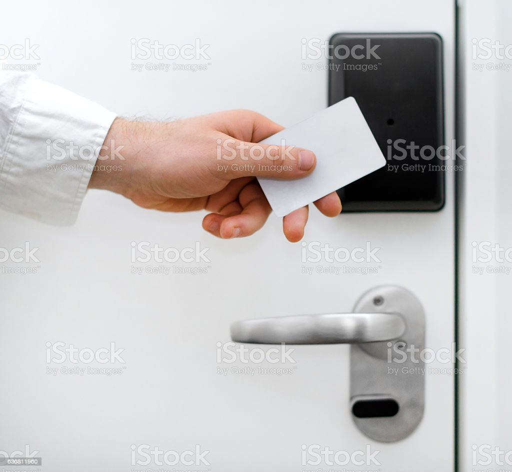 Man using contactless key in the hotel. stock photo