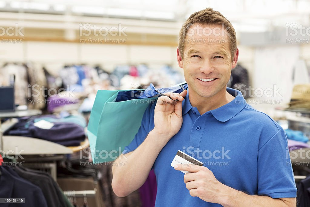 Man Using Credit Card For Shopping stock photo