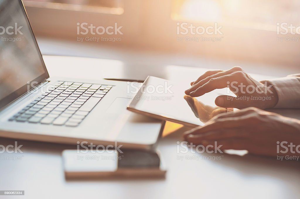 Man using digital tablet and laptop computer stock photo