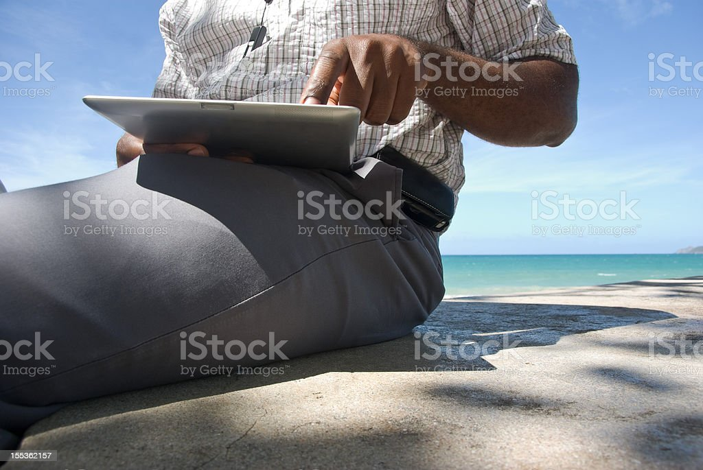 man using digital tablet PC outdoors royalty-free stock photo