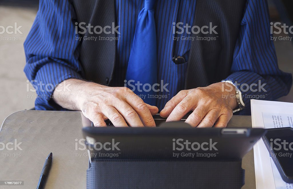 Man using digital tablet royalty-free stock photo