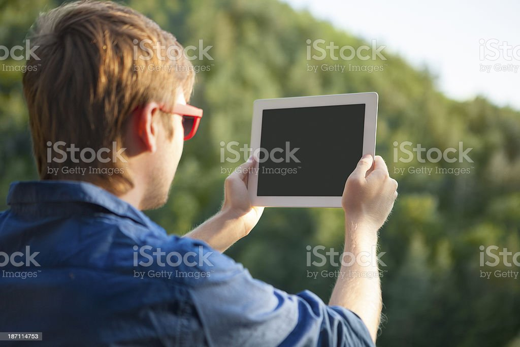 Man using digital tablet royalty-free stock photo