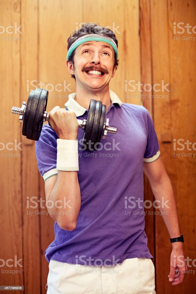 Man using dumbel stock photo