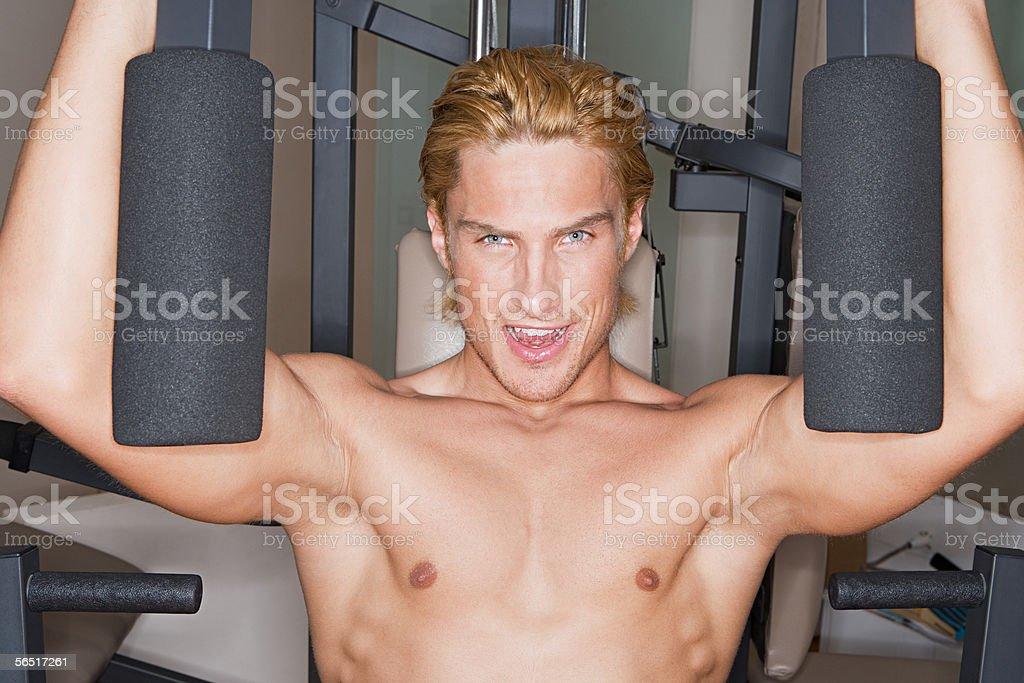 Man using exercise machine royalty-free stock photo