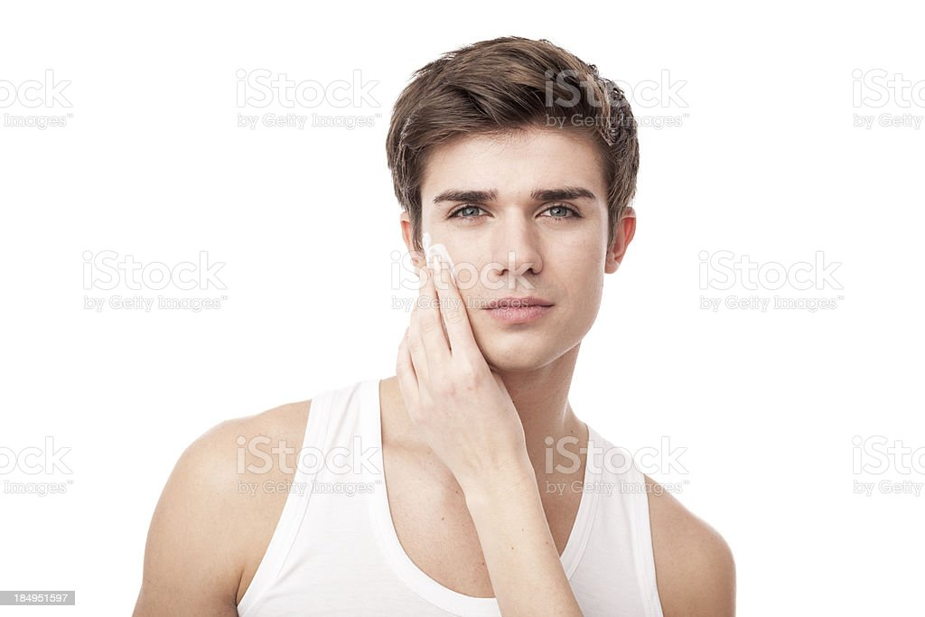 man using facial cream with woman help royalty-free stock photo