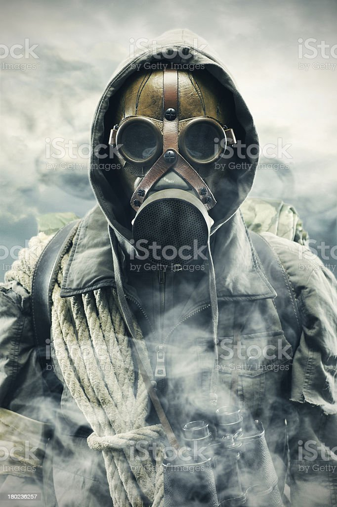 Man using gas mask to protect himself from pollution stock photo