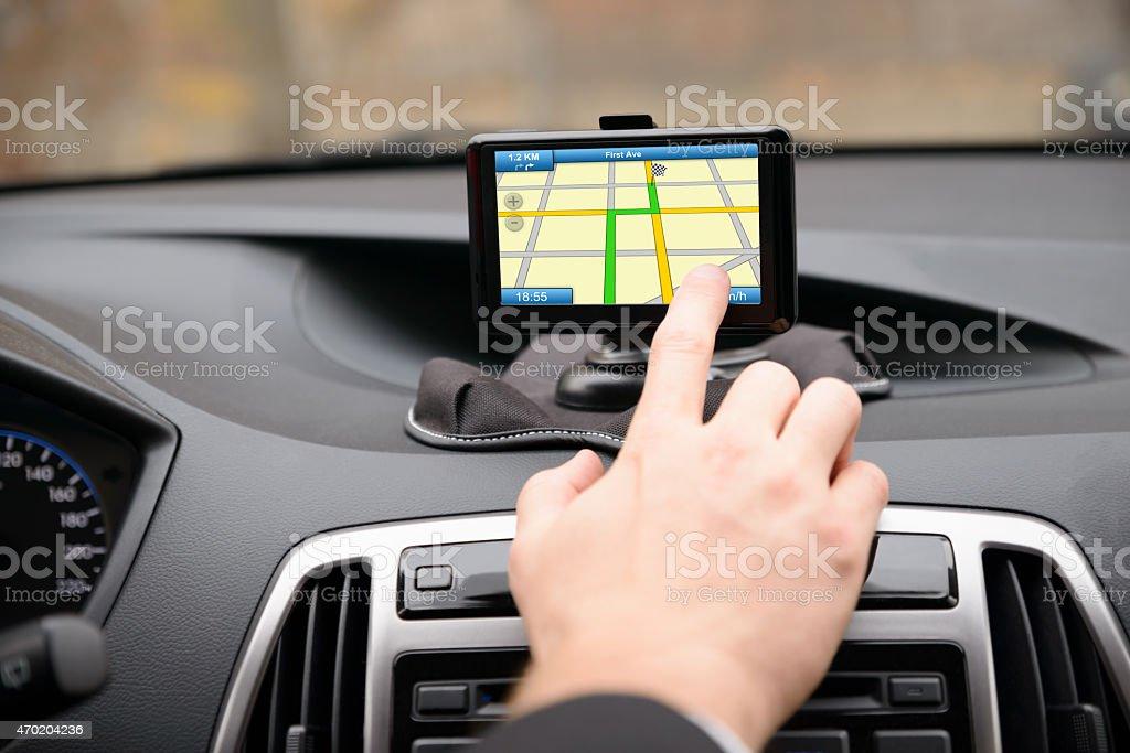 Man Using Gps Navigation While Driving stock photo