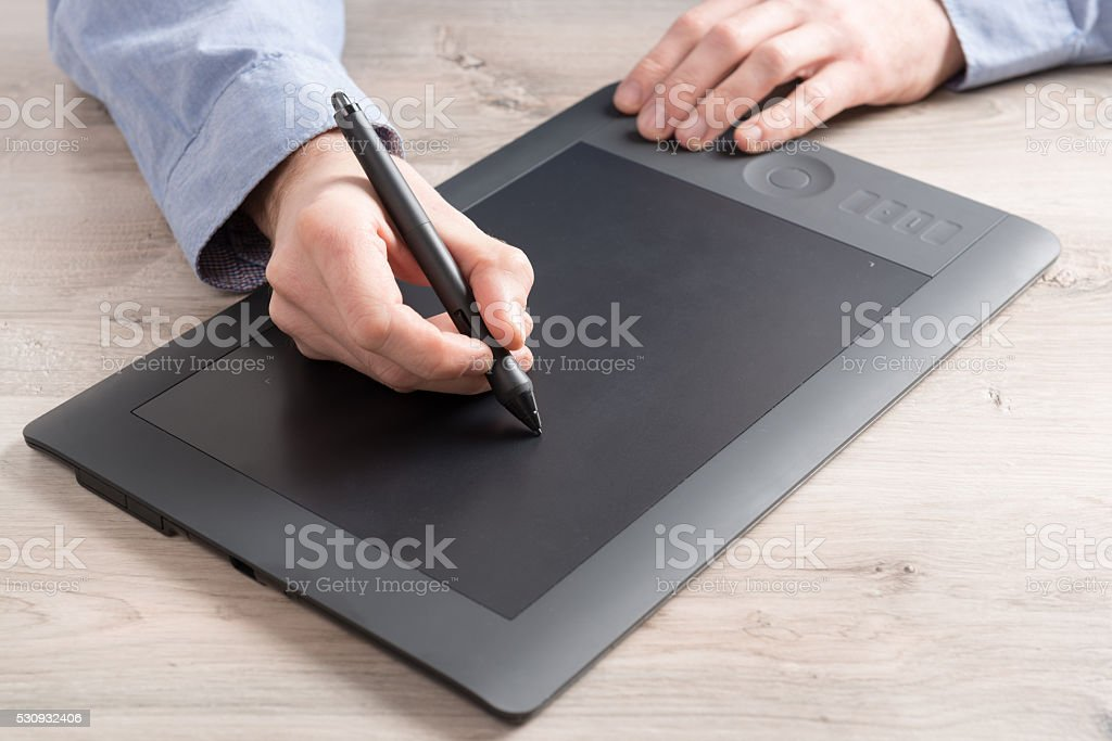 Man using graphical tablet stock photo