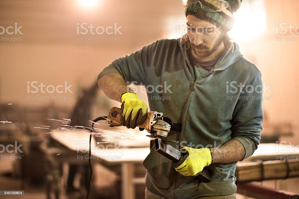 Man using grinder in workshop stock photo