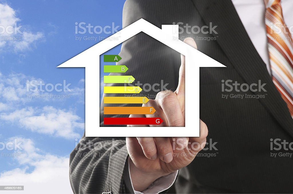 A man using his finger to draw a house royalty-free stock photo