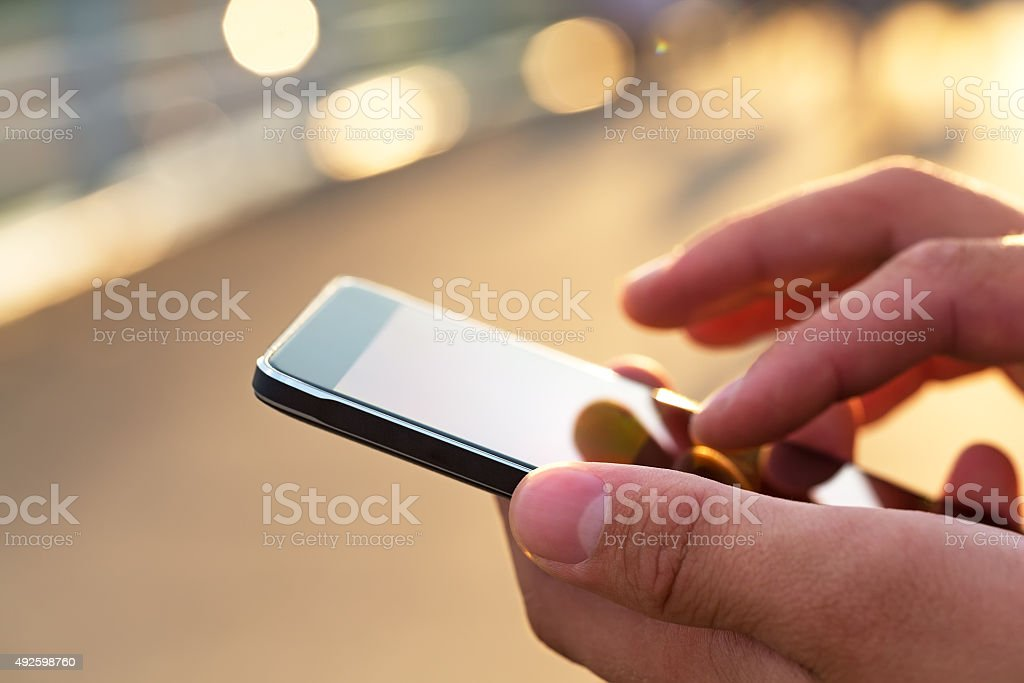 Man using his Mobile Phone outdoor stock photo