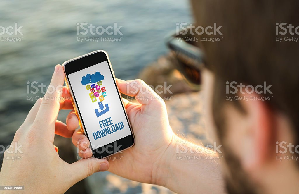 Man using his mobile phone to free download stock photo