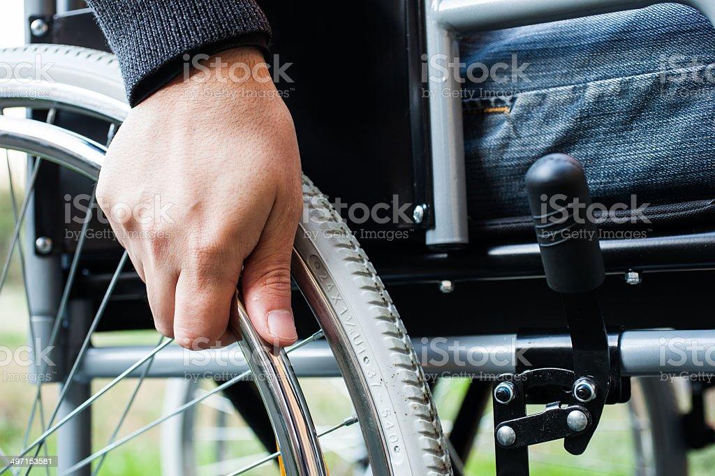 Man using his wheelchair stock photo
