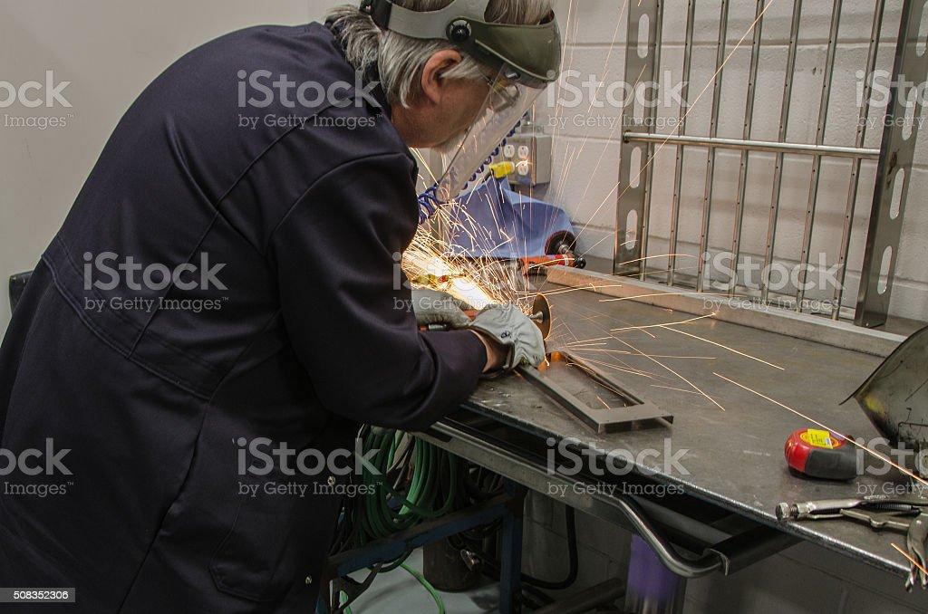 Man using industrial cutting wheel stock photo