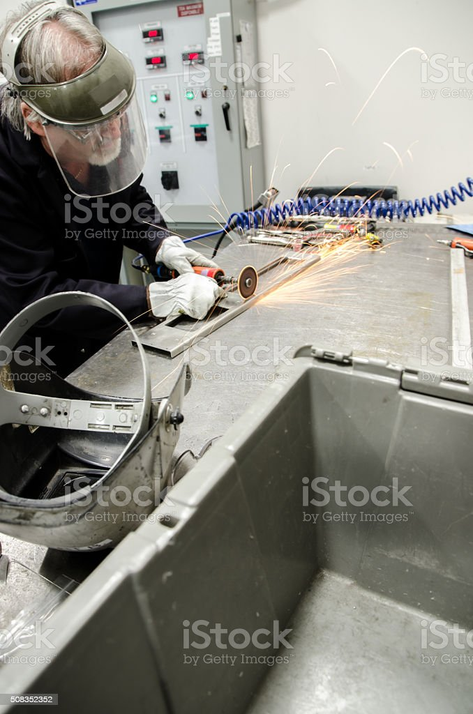 Man using industrial cutting wheel stock photo