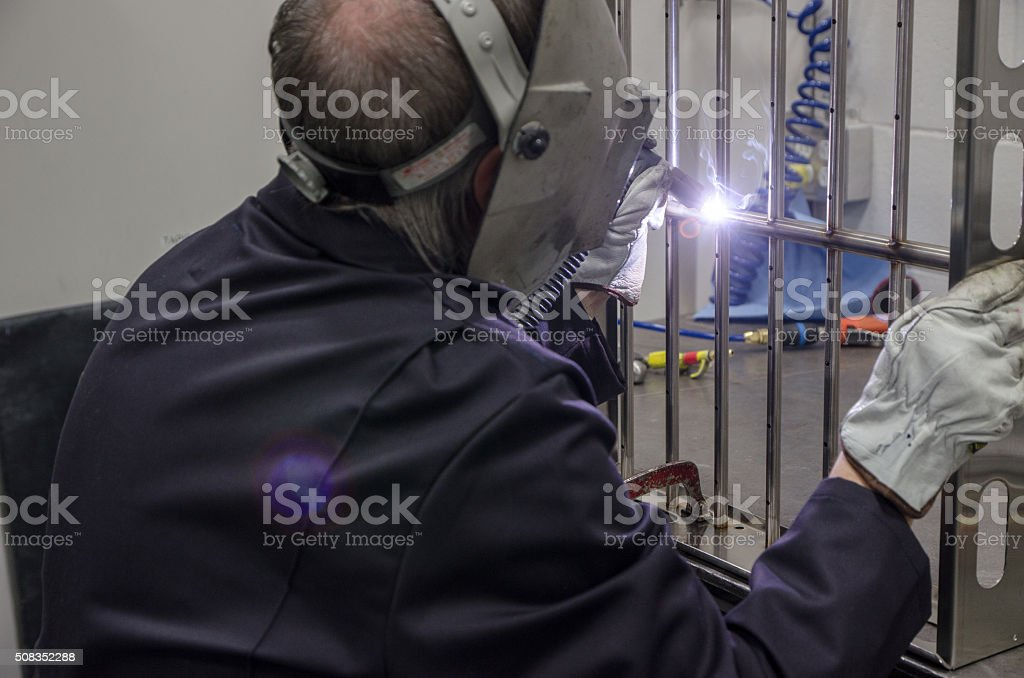 Man using industrial welder stock photo
