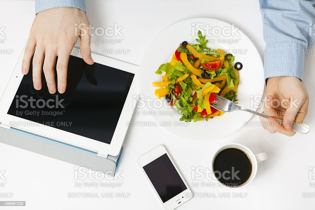 Man using iPad and iPhone royalty-free stock photo