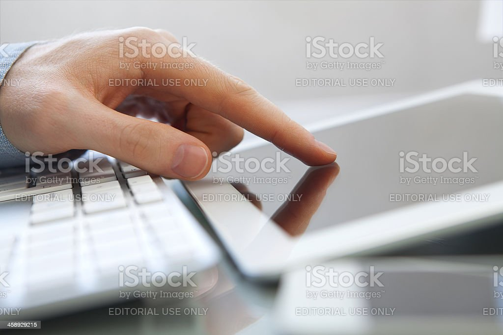 Man using iPad stock photo