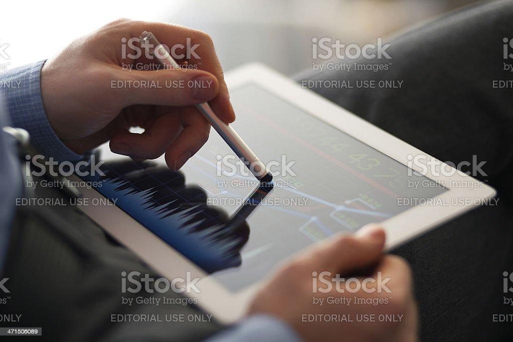 Man using iPad royalty-free stock photo