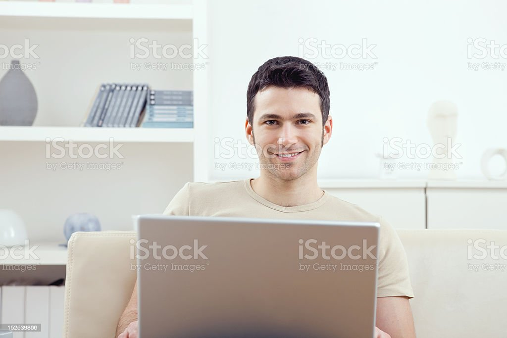 Man using laptop at home royalty-free stock photo