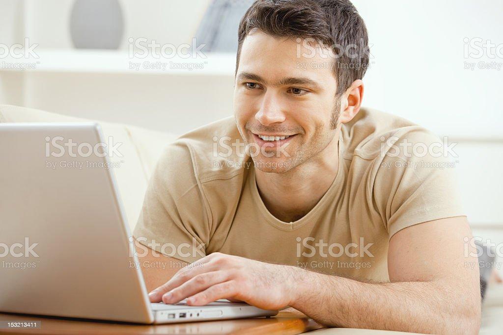 Man using laptop at home royalty-free stock photo