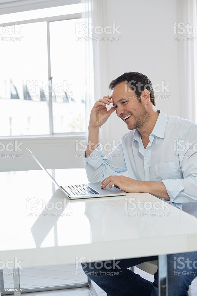 Man Using Laptop At Table royalty-free stock photo