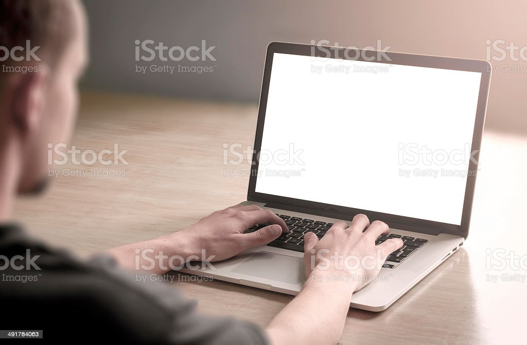 Man using laptop computer. stock photo
