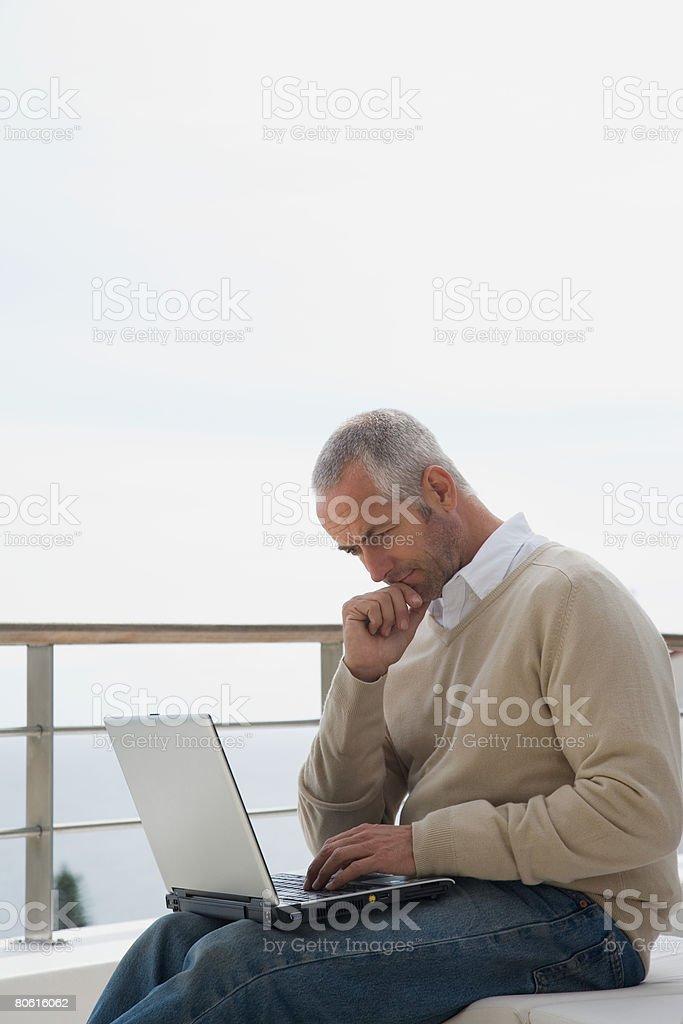 Man using laptop computer royalty-free stock photo