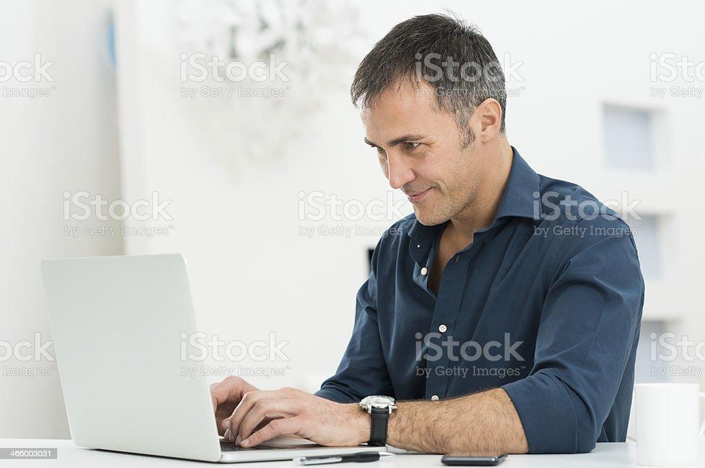 Man Using Laptop stock photo