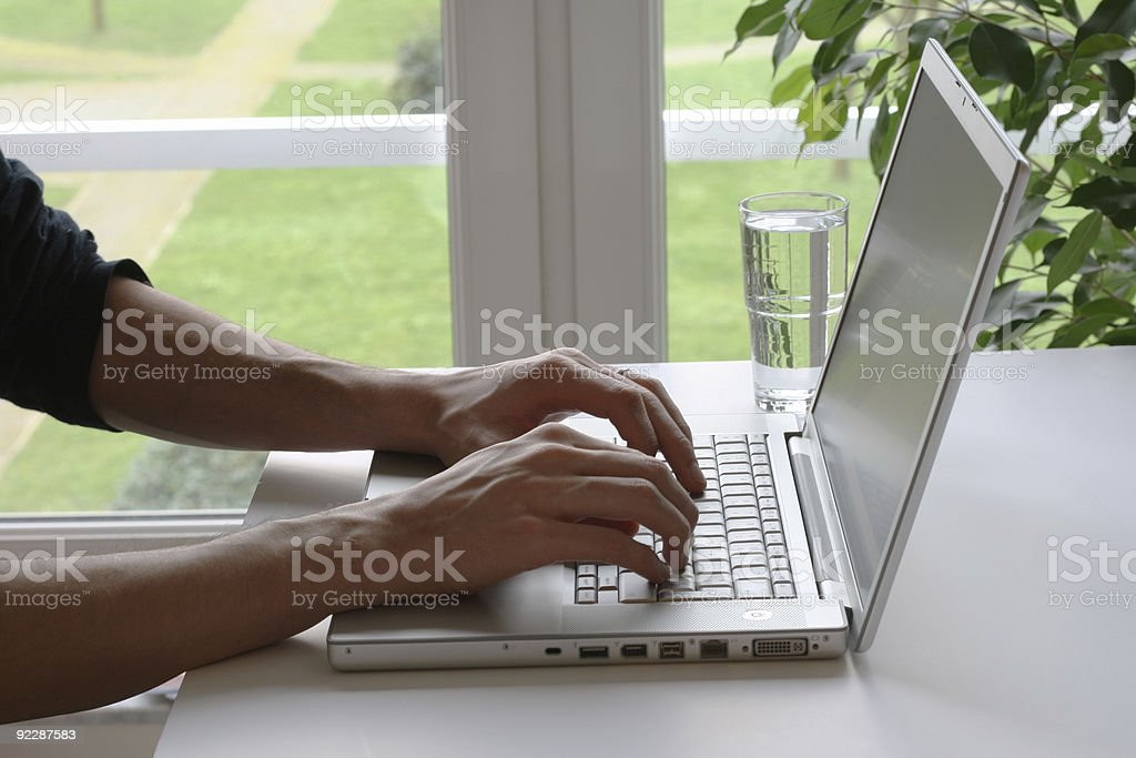 Man using laptop to work from home royalty-free stock photo