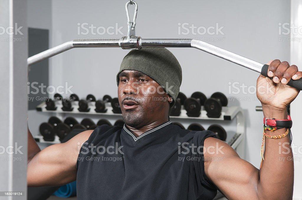 Man Using Lat Pulldown Machine royalty-free stock photo