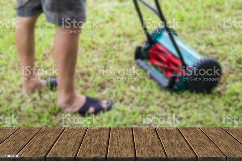 man using lawn mower stock photo