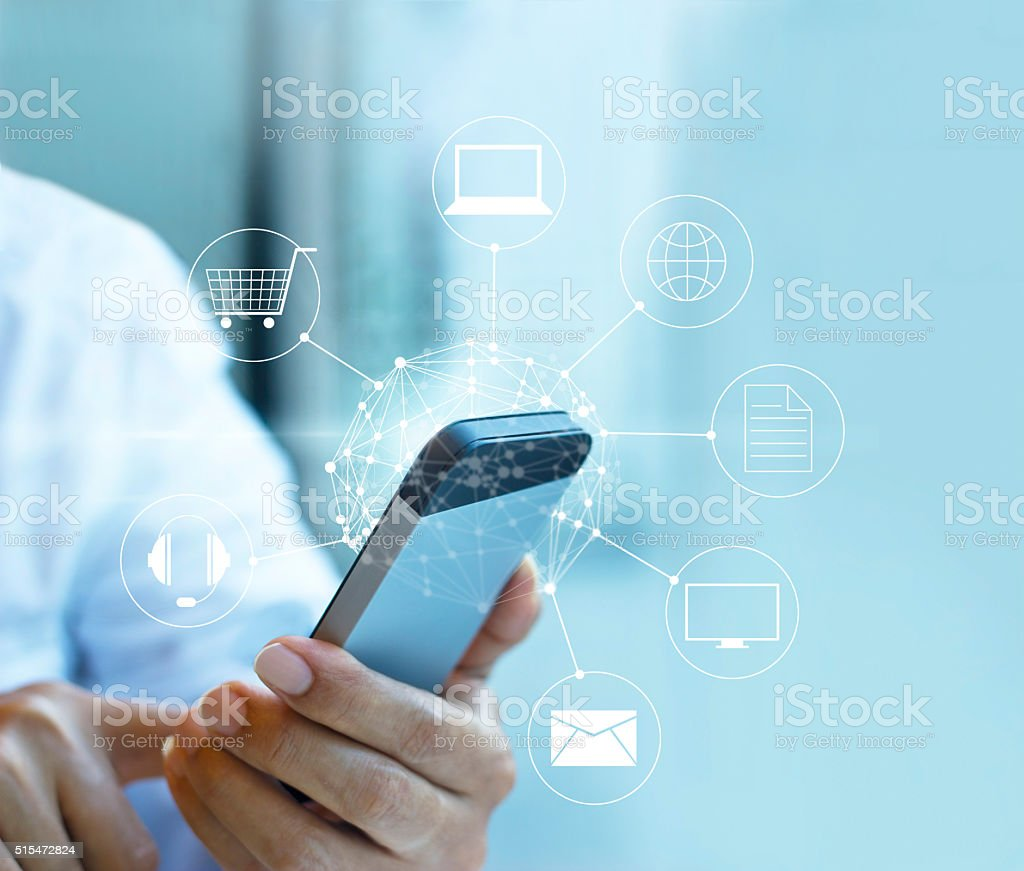 Man using mobile payment, holding circle global stock photo