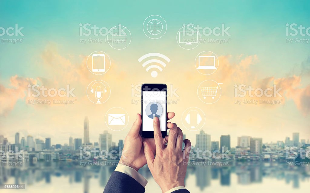 Man using mobile payments, holding circle global and icon custom stock photo