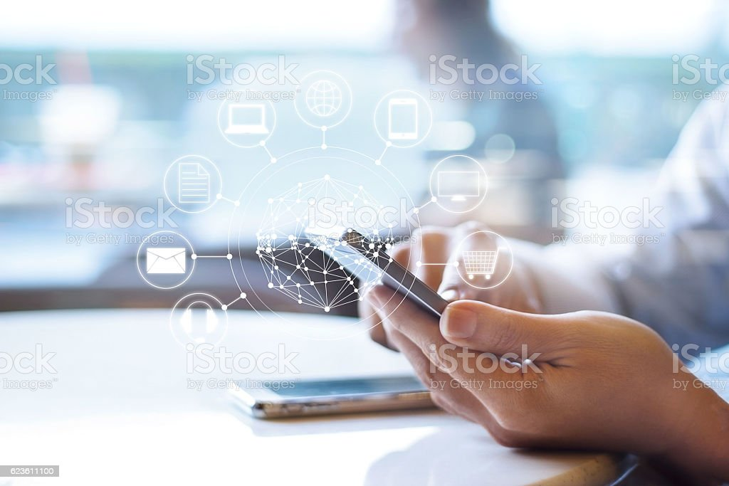 Man using mobile payments, holding circle global and icon customer stock photo