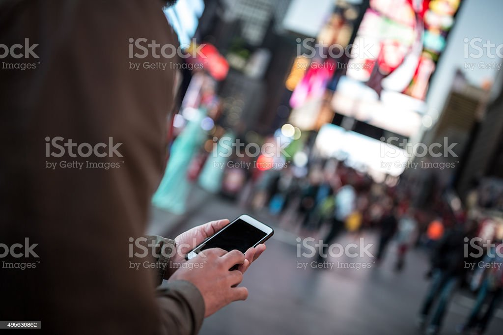 Man Using Mobile Phone in Time Square, NYC stock photo