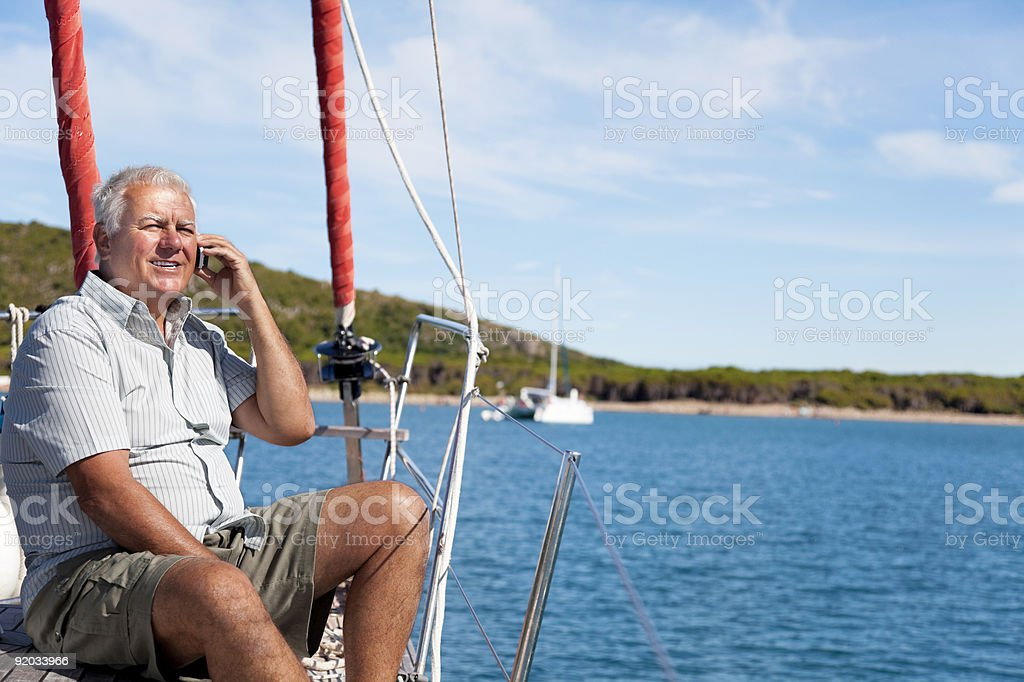 Man using mobile phone on the boat. royalty-free stock photo
