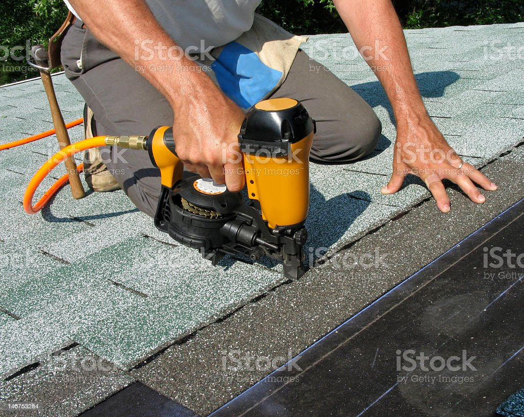Man using nail gun stock photo