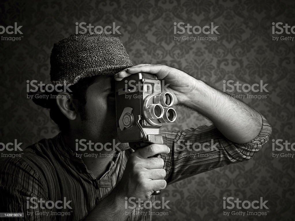 Man using old fashioned cinecamera stock photo