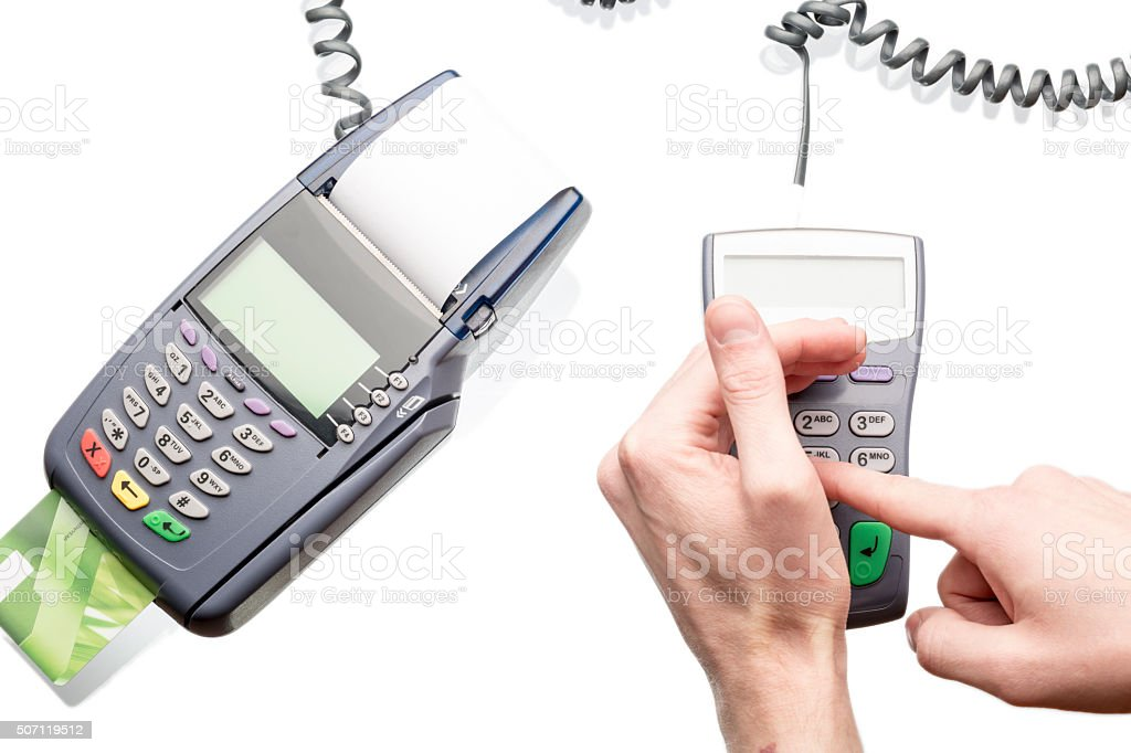 Man using payment terminal keypad stock photo