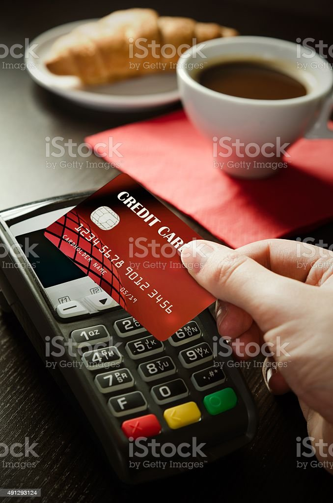 Man using payment terminal with NFC technology in cafeteria stock photo