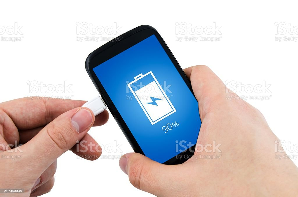 Man using phone charger via USB stock photo