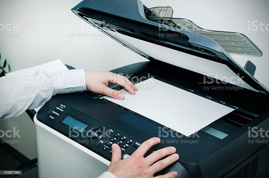 Man using scanner multifunction device in office stock photo