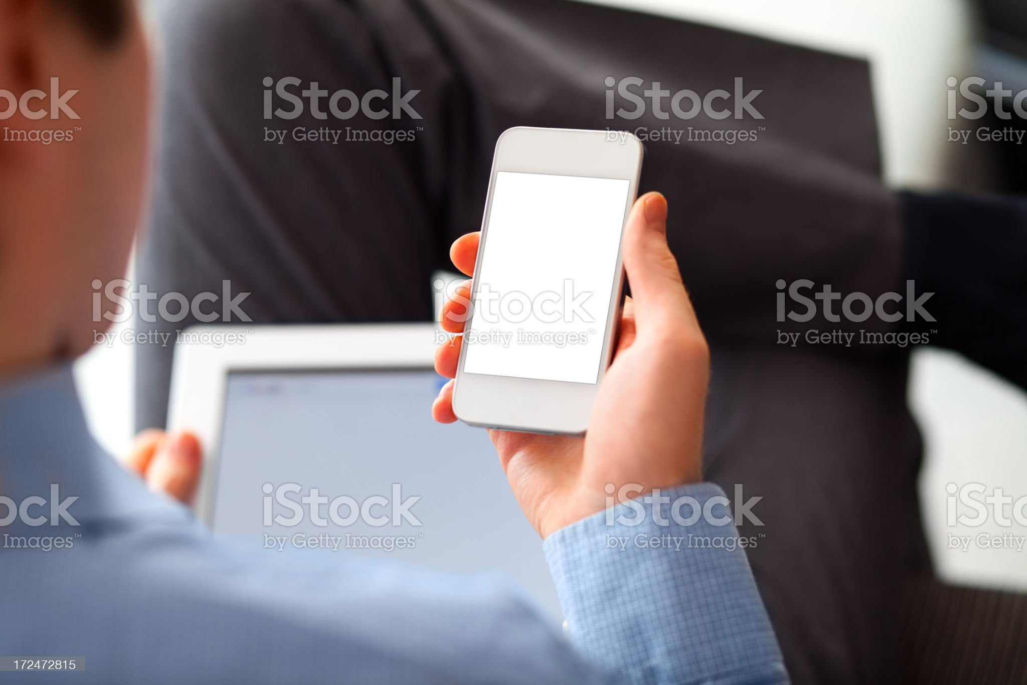 Man Using Smart Phone and Digital Tablet royalty-free stock photo