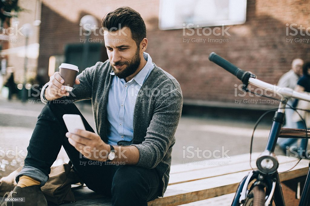 Man using smart phone stock photo