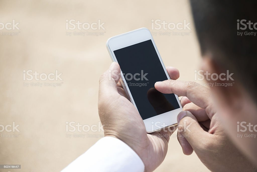 Man Using Smart Phone stock photo