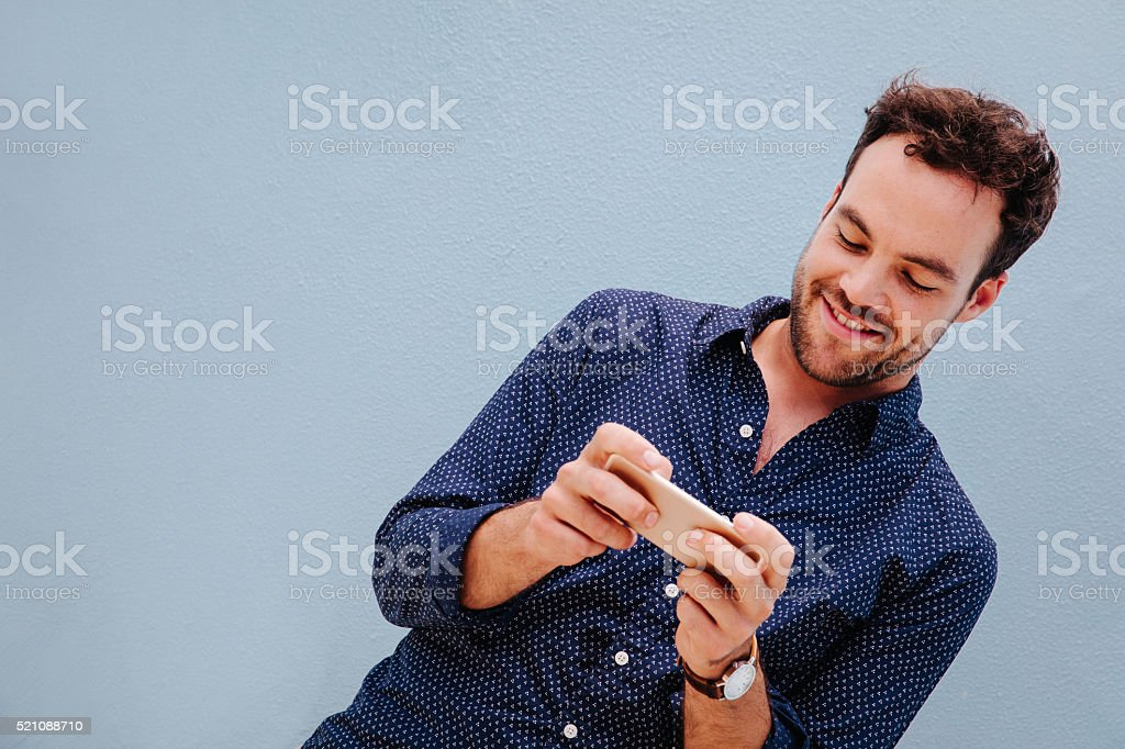 Man using smart phone to play the games stock photo