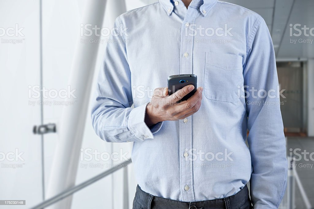 Man using smartphone royalty-free stock photo